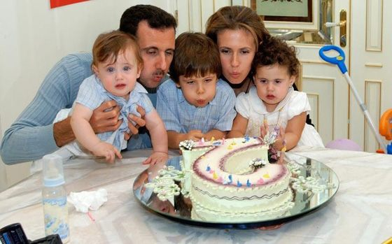 Bashar Al-Assad with his wife and children