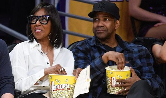Denzel Washington and his wife at a basketball match