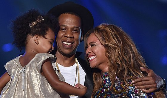 Jay-Z with wife and daughter