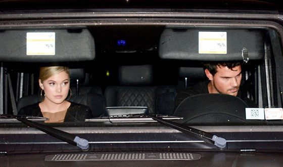 Olivia Holt and Taylor Lautner in one car